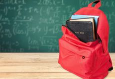 Holy Bible book in School Backpack. Front view studio shot book bag religious text holy book bible study red Stock Image