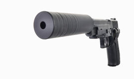 Front view of a Suppressed Pistol with a big hole in the front. Front view of a compact pistol with hammer cocked and suppressor ready to fire isolated on a Royalty Free Stock Image