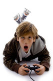 Front view of surprised kid playing videogame Royalty Free Stock Images