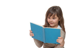 Front view of surprised little girl reading a book Stock Photo