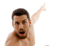 Front view of surprised man pointing Stock Images