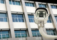 Front view of surveillance camera against building backgr Stock Images