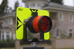Front View of Surveyor's Prism. Close up of a surveyor's prism in an urban setting stock images