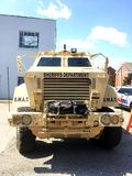 Sheriffs Department S.W.A.T. Vehicle. A front view of a tan Sheriffs Department tactical S.W.A.T. Vehicle parked with a police car on the side royalty free stock photos