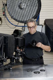 Front view of a technician in photographer's studio Stock Photos