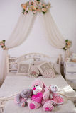 Front view of Teddy bear toy with I love you. In the background bed.  Royalty Free Stock Image