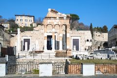 Front view of Tempio Capitolino in Brescia. Travel to Italy - front view of ancient roman monument Capitolium of Brixia (Temple of the Capitoline Triad in stock images