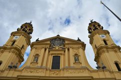 Front view of the Theatinerkirche at the Odeonsplatz in Munich in Germany. During bad weather royalty free stock image