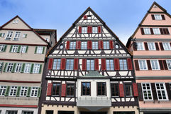 Front view of three old typical half-timbered houses with shutters. Royalty Free Stock Photos