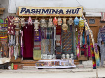 Front view of Tibetan shop clothes and souvenirs in Leh, Ladakh, India. LEH, INDIA - JUNE 29, 2015 : Front view of Tibetan shop clothes and souvenirs outside the royalty free stock image