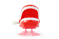 Front view of toy clockwork open jaw on pink legs Royalty Free Stock Photos