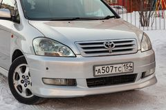 Front view of Toyota Ipsum last generation in silver color after cleaning before sale in a winter day and snow background. Novosibirsk, Russia - 03.10.2019 stock image