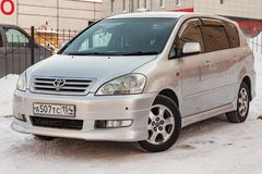 Front view of Toyota Ipsum last generation in silver color after cleaning before sale in a winter day and snow background. Novosibirsk, Russia - 03.10.2019 stock photos