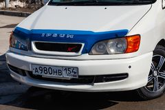 Front view of Toyota Ipsum 1998 year in white color after cleaning before sale on parking. Novosibirsk, Russia - 04.10.2019: Front view of Toyota Ipsum 1998 year stock photography