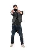 Front view of trendy young man taking photo with mobile phone Royalty Free Stock Images