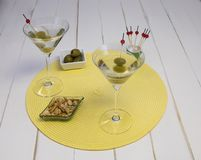 Front View of Two Martinis on Placemat royalty free stock image