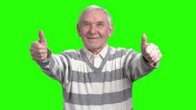 Front view of two thumps up from old man. Merry grandpa with thumbs up in green hromakey background stock video