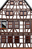 Front view of a typical half-timbered house. Front view of a typical half-timbered house with brown frame, white filling and brown windows Royalty Free Stock Photography