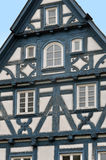 Front view of a typical half-timbered house with dark blue frame. Front view of a typical half-timbered house with dark blue frame, white filling. Waiblingen Royalty Free Stock Photos