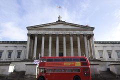 Front view of University College London main building with a double decker bus and beautiful sky royalty free stock images