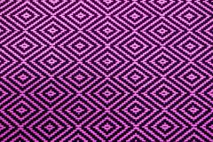 Front view of vibrant purple and black ethnic pattern fabric for background. Or banner abstract art backdrop cloth color colorful decoration design diamond royalty free stock photography