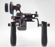 Front view of video shoulder rig shape. Front view of a Rig shape for field recording that can fit C100, C200, C300 Canon cameras. With follow focus Stock Images