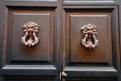 Old vintage lion head door knocker. Royalty Free Stock Images