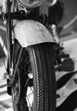 Front view of a vintage motorcycle. Close up of a beautiful vintage motorcycle, black and white image Stock Image