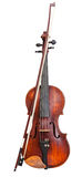 Front view of violin with wooden chinrest and bow Royalty Free Stock Image