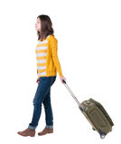 Front view of walking  woman  with suitcase. Stock Images