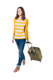 Front view of walking  woman  with suitcase. Royalty Free Stock Image