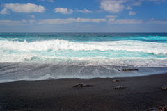 Front view of waves on a black sand beach on Playa del Paso in Lanzarote, Canary Islands Spain Royalty Free Stock Image