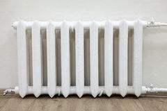 Front view white iron radiator central heating is in room Royalty Free Stock Images