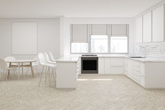 Front view of white kitchen with poster Stock Photo