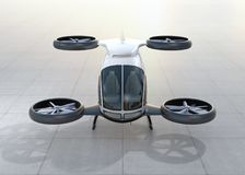 Front view of white self-driving passenger drone landing on the ground. 3D rendering image Stock Photo