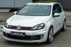 Front view of white Volkswagen Golf GTI MK6 parked in the street
