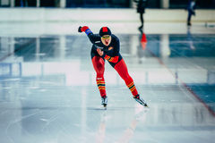 Front view of woman athlete speedskater running sprint track Stock Image
