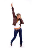 Front view of woman enjoying music Royalty Free Stock Photography