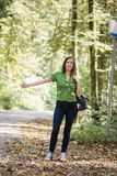 Front view of a woman hitchhiker stock images