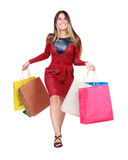 Front view of a woman jumping with shopping bags Royalty Free Stock Photos