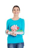 Front view woman with piggybank and notebooks Royalty Free Stock Images
