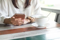 Front view. woman playing mobile phone while take a break in mor Stock Image