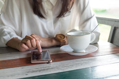 Front view. woman playing mobile phone while take a break in mor Royalty Free Stock Images