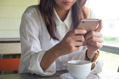 Front view. woman playing mobile phone while take a break in mor Stock Photo
