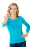 Front view woman pushing imaginary button Stock Image