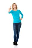 Front view woman pushing imaginary button Royalty Free Stock Images