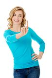 Front view woman pushing imaginary button Stock Photos