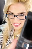 Front view of woman showing cell phone Royalty Free Stock Photos