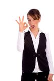 Front view of woman showing ok sign Stock Photos