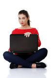 Front view woman sitting cross-legged with laptop Royalty Free Stock Images